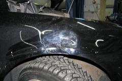 покусанное крыло машины